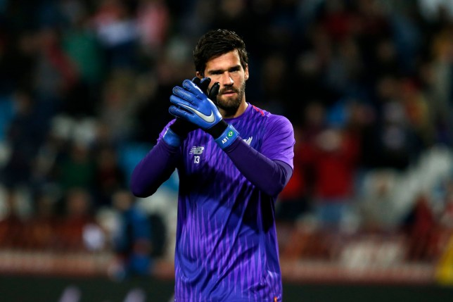 Liverpool goalkeeper Alisson warms up before the Champions League group C soccer match between Red Star and Liverpool at Rajko Mitic stadium in Belgrade, Tuesday, Nov. 6, 2018. (AP Photo/Darko Vojinovic)
