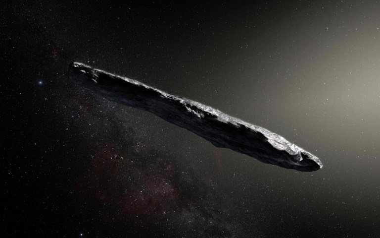 """This handout image of artist's impression released by the European Southern Observatory on November 20, 2017 shows the first interstellar asteroid: Oumuamua. - A scientific paper led by two researchers at Harvard University made a splash this week by claiming that a cigar-shaped rock zooming through our solar system may have been sent by aliens. The researchers noted in pre-print of the article that it was an """"exotic scenario,"""" but that """"Oumuamua may be a fully operational probe sent intentionally to Earth vicinity by an alien civilization."""" (Photo by M. Kornmesser / European Southern Observatory / AFP) / RESTRICTED TO EDITORIAL USE - MANDATORY CREDIT """"AFP PHOTO / EUROPEAN SOUTHERN OBSERVATORY / M. Kornmesser"""" - NO MARKETING NO ADVERTISING CAMPAIGNS - DISTRIBUTED AS A SERVICE TO CLIENTSM. KORNMESSER/AFP/Getty Images"""