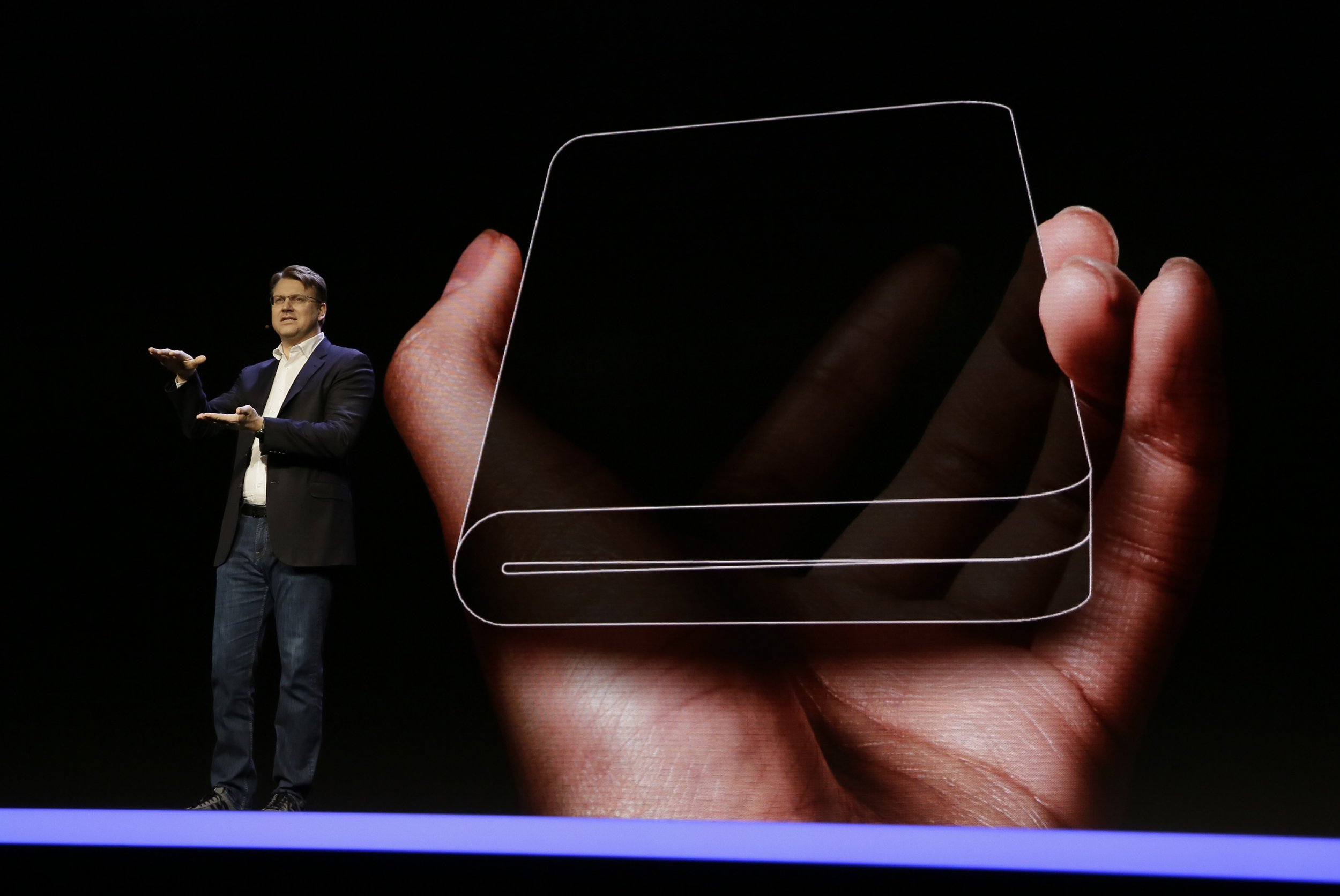 Justin Denison, SVP of Mobile Product Development, talks about the Infinity Flex Display of a folding smartphone during the keynote address of the Samsung Developer Conference, Wednesday, Nov. 7, 2018, in San Francisco. (AP Photo/Eric Risberg)