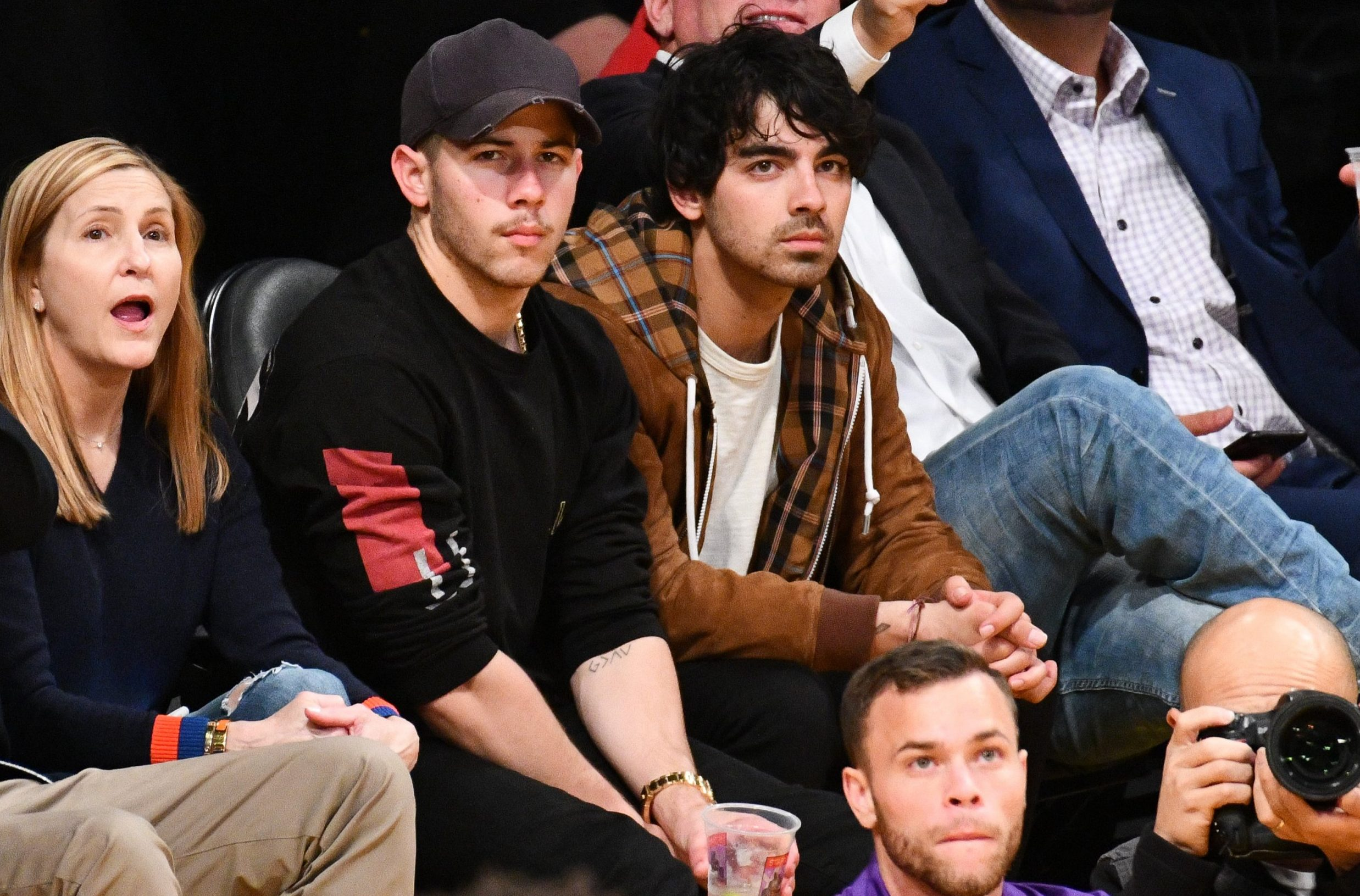 LOS ANGELES, CALIFORNIA - NOVEMBER 07: Nick Jonas and Joe Jonas attend a basketball game between the Los Angeles Lakers and and the Minnesota Timberwolves at Staples Center on November 07, 2018 in Los Angeles, California. (Photo by Allen Berezovsky/Getty Images)