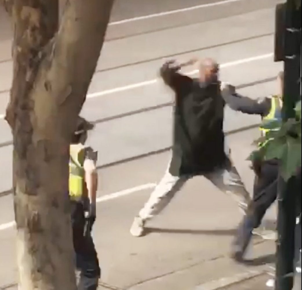 epa07152648 A screenshot taken from a supplied video made available to AAP shows an incident n which a man armed with a knife attacked several people on Bourke Street in Melbourne, Australia, 09 November 2018. According to early media reports, an unidentified man set a vehicle alight and stabbed two people before being shot by police in the Central Business District of Melbourne. At least one person was killed during the incident. The perpetrator was taken into custody and is reportedly in critical condition. EPA/STR AUSTRALIA AND NEW ZEALAND OUT EDITORIAL USE ONLY