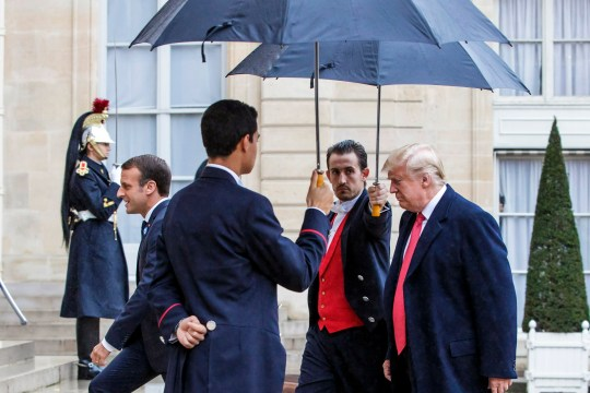 epa07154908 French President Emmanuel Macron (L) greets US President Donald J. Trump (R) upon his arrival at the Elysee Palace in Paris, France, 10 November 2018. US President Trump along with other Heads of States and Governments will join on 11 November the commemoration ceremonies for their countries' fallen WW1 soldiers in France. EPA/CHRISTOPHE PETIT TESSON