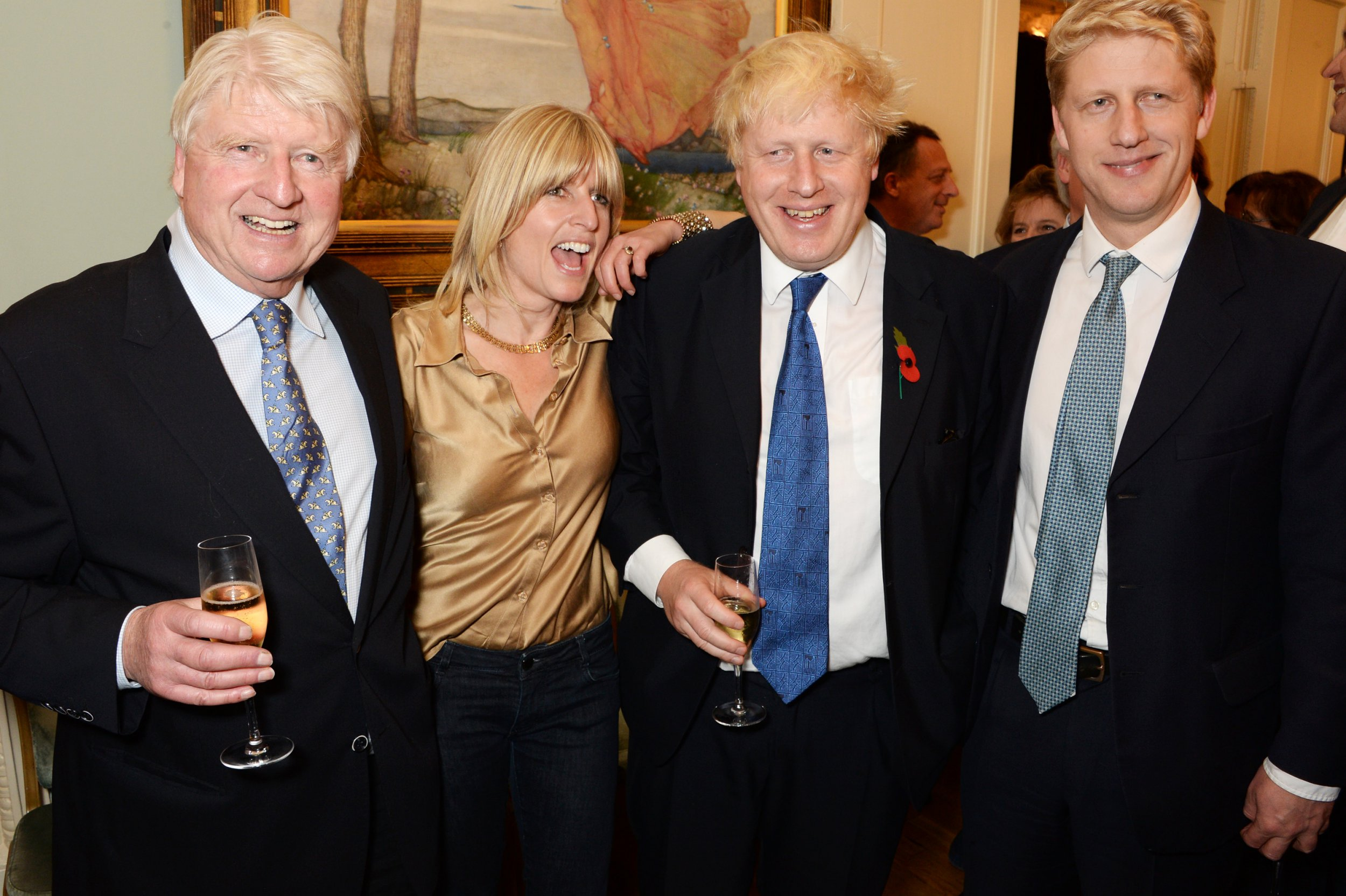 """LONDON, ENGLAND - OCTOBER 22: (L to R) Stanley Johnson, Rachel Johnson, Mayor of London Boris Johnson and Jo Johnson attend the launch of Boris Johnson's new book """"The Churchill Factor: How One Man Made History"""" at Dartmouth House on October 22, 2014 in London, England. (Photo by David M. Benett/Getty Images)"""