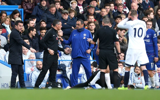 """Everton manager Marco Silva (left) seems frustrated as Chelsea manager Maurizio Sarri (centre) looks on during the Premier League match at Stamford Bridge, London. PRESS ASSOCIATION Photo. Picture date: Sunday November 11, 2018. See PA story SOCCER Chelsea. Photo credit should read: Steven Paston/PA Wire. RESTRICTIONS: EDITORIAL USE ONLY No use with unauthorised audio, video, data, fixture lists, club/league logos or """"live"""" services. Online in-match use limited to 120 images, no video emulation. No use in betting, games or single club/league/player publications."""