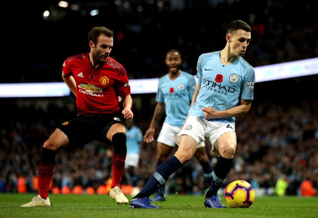 "Manchester City's Phil Foden (right) in action during the Premier League match at the Etihad Stadium, Manchester. PRESS ASSOCIATION Photo. Picture date: Sunday November 11, 2018. See PA story SOCCER Man City. Photo credit should read: Nick Potts/PA Wire. RESTRICTIONS: EDITORIAL USE ONLY No use with unauthorised audio, video, data, fixture lists, club/league logos or ""live"" services. Online in-match use limited to 120 images, no video emulation. No use in betting, games or single club/league/player publications."