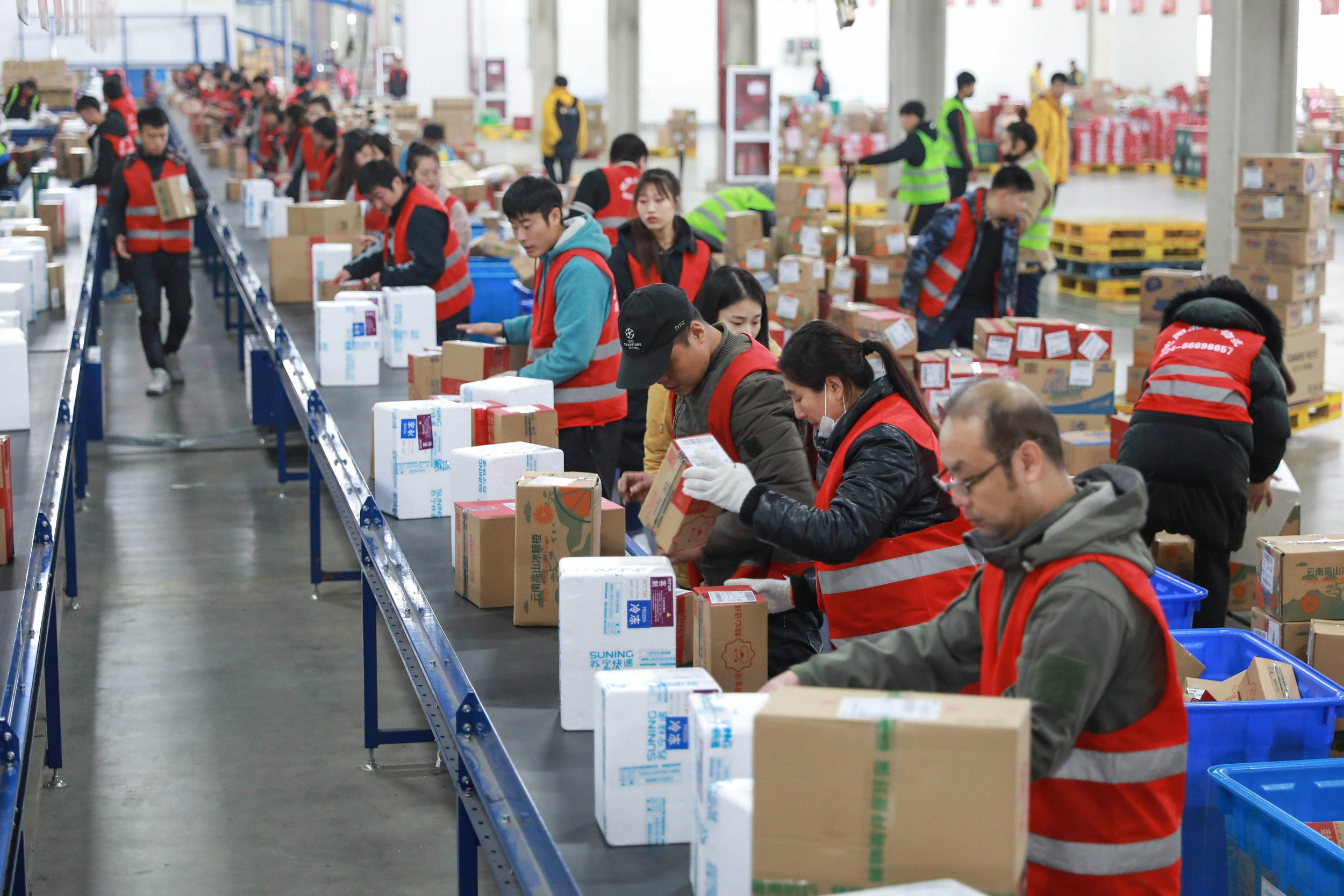 """This photo taken on November 9, 2018 shows workers preparing items ahead of the """"Singles Day"""" shopping festival at a Suning storage facility in Shenyang in China's northeastern Liaoning province. (Photo by STR / AFP) / China OUTSTR/AFP/Getty Images"""