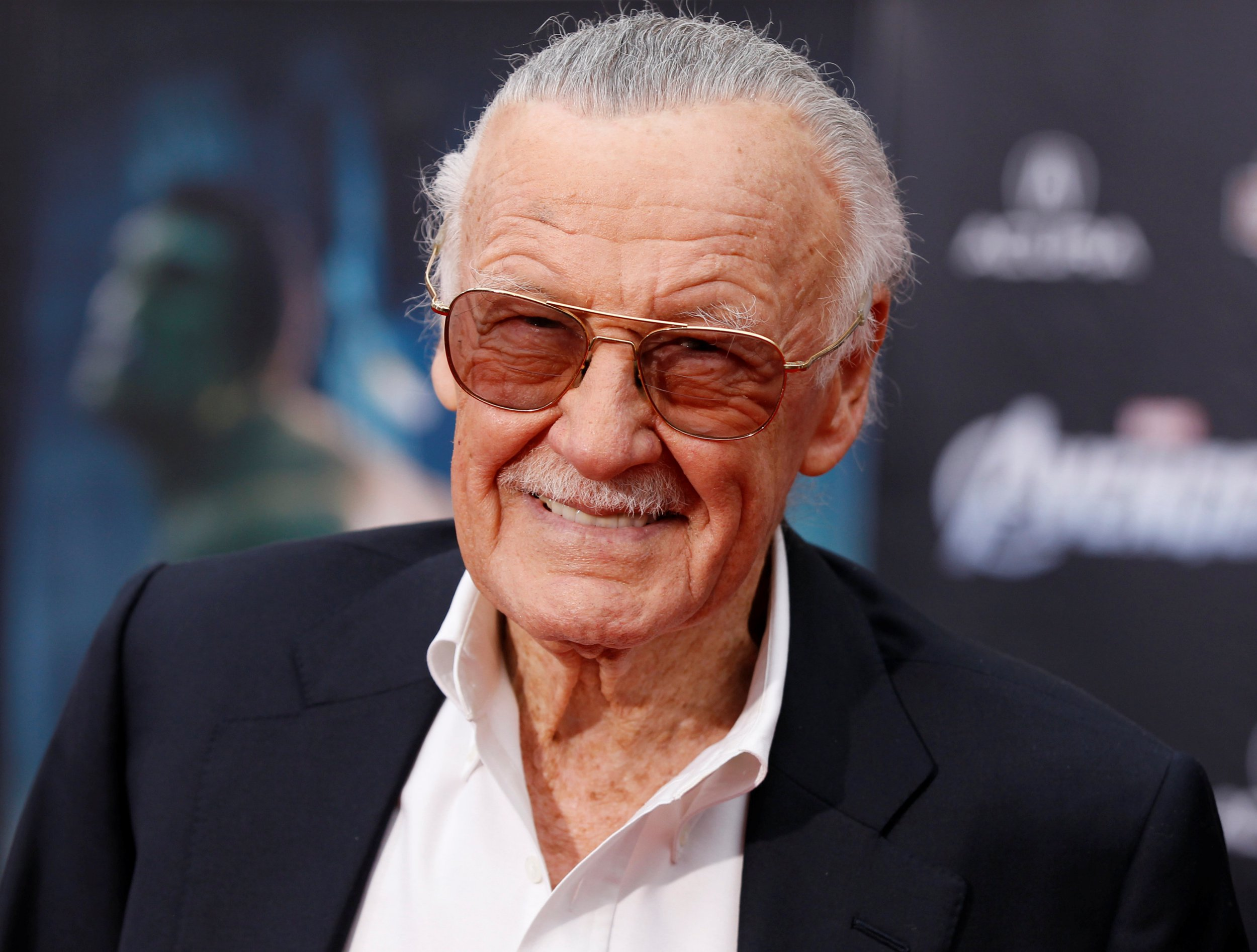 "FILE PHOTO - Comic book creator and executive producer Stan Lee poses at the world premiere of the film ""Marvel's The Avengers"" in Hollywood, California, April 11, 2012. REUTERS/Danny Moloshok/File Photo"