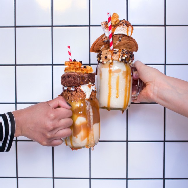 USA: Feature Rates Apply MANDATORY CREDIT: Zoe Flammang/REX Shutterstock Editorial use only. No stock, books, merchandising or advertising without photographer's permission Mandatory Credit: Photo by Zoe Flammang/REX/Shutterstock (5768172d) Introducing the Freakshake: an indulgent, giant, dribbling ice cream topped with cake, brownies, crushed cookies, marshmallows and sauces Ultimate milkshake 'freakshakes', London - Jul 2016 FULL COPY: http://www.rexfeatures.com/nanolink/sjgs Who needs a milkshake when you can have a 'freakshake'? The freakshake is another extreme-foodie trends that has been taking Instagram by storm over the past few months. Freaskshakes are an indulgent giant dribbling ice cream topped with cake, brownies, crushed cookies, marshmallows and sauces. These ridiculously tasty creations are the work of Molly Bakes in Dalston, East London. Molly Bakes offers freakshakes in raspberry, peanut butter, sated caramel and chocolate. Diners can chose their own toppings, which include a delicious mix of cookies, tarts, brownies and many, many more. The freakshakes are in such high demand that it is not uncommon for there to be a two-hour queue on the weekends.