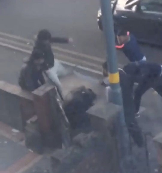 - Image taken from a video showing a man being attacked with knives in Birmingham, NB: Original copyright owner unknown however video has been uploaded to Facebook TRIANGLE NEWS 0203 176 5581 // contact@trianglenews.co.uk A shocking video captured the moment that a vicious gang armed with machetes HACKED at a man in the street in broad daylight. The horrifying moment captures the sickening seven-on-one street attack which took place in Birmingham on Friday afternoon. The footage, filmed by a terrified onlooker from a nearby house, shows the man being shoved to the ground before he is repeatedly kicked and slashed. *Full copy filed via the wires/Triangle News*