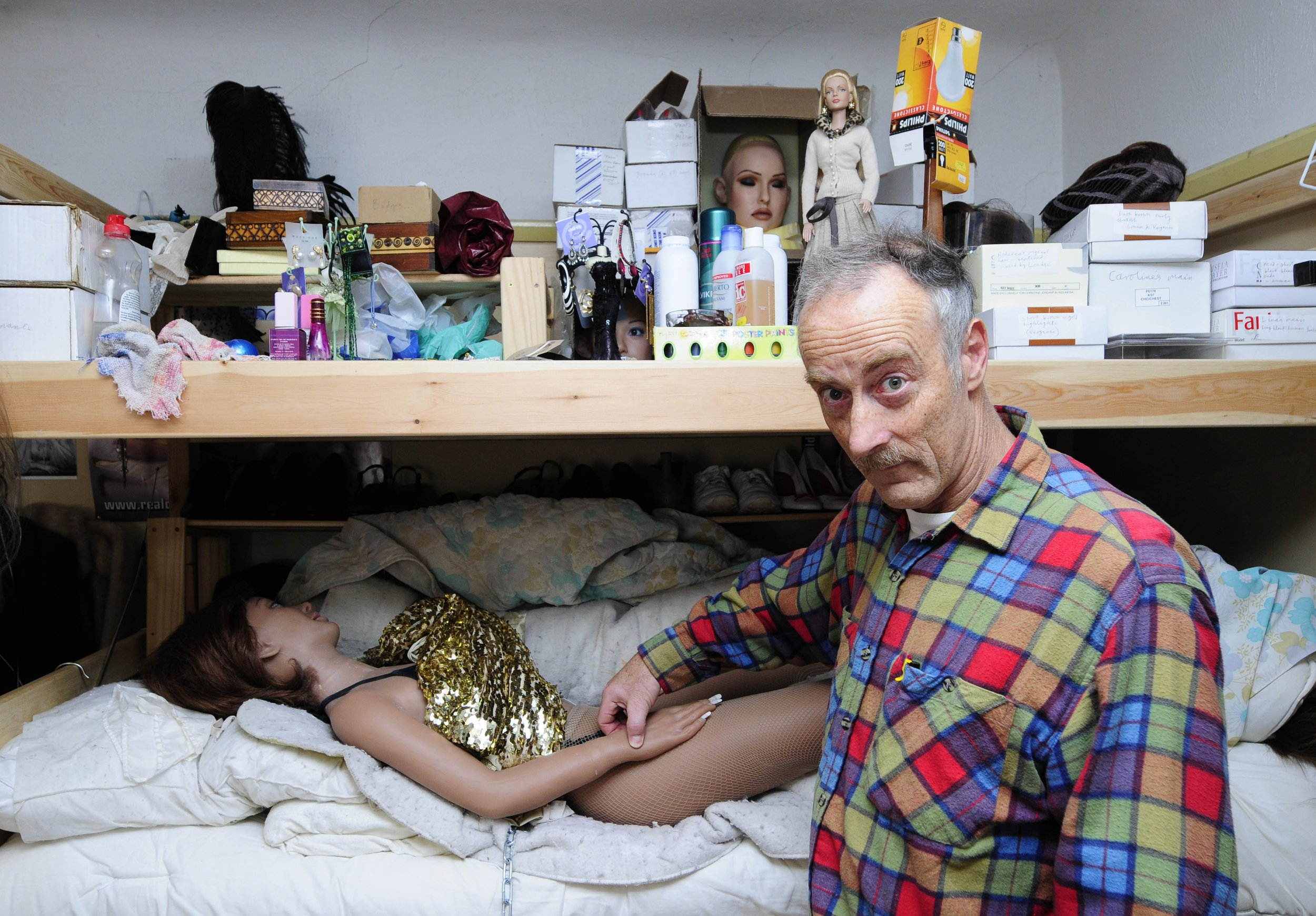 ***EXCLUSIVE*** BOURNEMOUTH, UK: Everard Cunion rearranges one of his dolls. Everard Cunion lives with five women but they are all dolls. Each doll costs him ?5000 and he bought his first doll in 2000. Everard is now dressing his dolls up as Girls Aloud after becoming a fan of the girl group. PHOTOGRAPH BY MARK CLIFFORD / BARCROFT MEDIA LTD UK Office, London. T +44 845 370 2233 W www.barcroftmedia.com Australasian & Pacific Rim Office, Melbourne. E info@barcroftpacific.com T +613 9510 3188 or +613 9510 0688 W www.barcroftpacific.com Indian Office, Delhi. T +91 997 1133 889 W www.barcroftindia.com