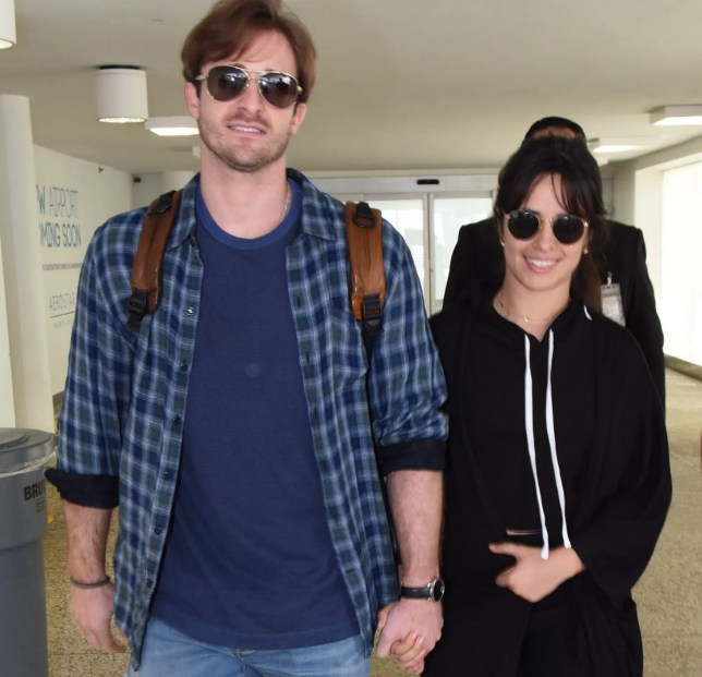 Camila Cabello and her boyfriend Matthew Hussey seen arriving at LMM airport in San Juan, Puerto Rico. Camila will be performing tonight at the Puerto Rico Coliseum in San Juan, PR, in the last concert of her 'Never be the same tour 2018?, cllosing her 2018 world tour. She arrived today wearing a black outfit and sun glasses. Camila was happy and had a big smile on her face, as she walked out of the airport terminal holding hands with her boyfriend Matthew Hussey. Pictured: Camila Cabello,Matthew Hussey Ref: SPL5035735 231018 NON-EXCLUSIVE Picture by: Photopress PR / SplashNews.com Splash News and Pictures Los Angeles: 310-821-2666 New York: 212-619-2666 London: 0207 644 7656 Milan: +39 02 4399 8577 Sydney: +61 02 9240 7700 photodesk@splashnews.com World Rights,