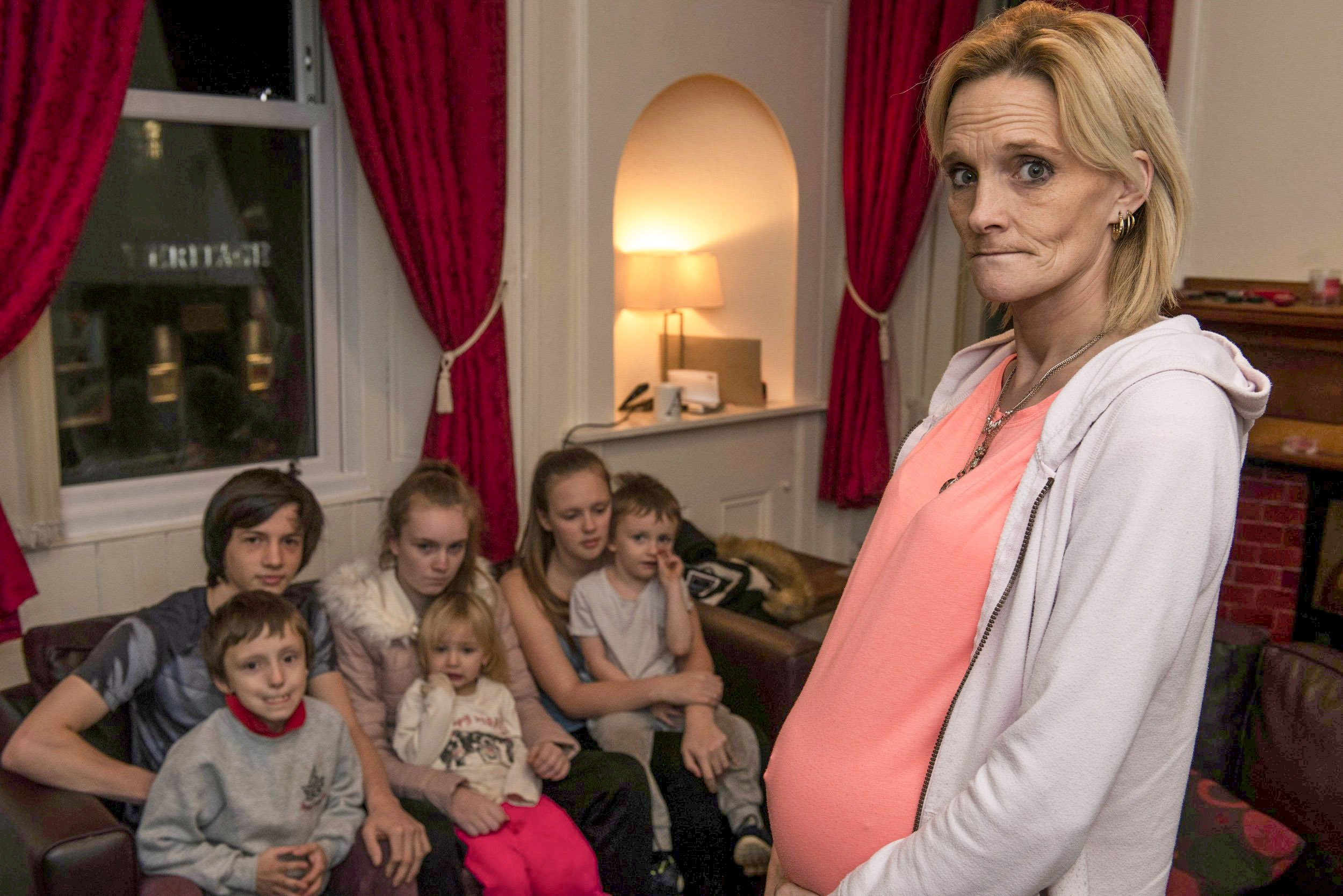Alana Burns, 38, who is due to give birth in March and lives with her children Alisha, aged two, Steven, aged four, Cayden, aged seven, Leigh, aged 15, and Caitlin, 16. Adult children Stewart, 20, and Bryan, 19, also stay with her in a flat above a pub in Bathgate, West Lothian. The flat has four bedrooms but the family are squeezing into three of them as a leak makes one bedroom uninhabitable. See SWNS story SWSCpregnant; A mum-of-seven who is pregnant with twins described living in a four-bedroom council flat as ???hell??? and demanded to be rehoused. Alana Burns, 38, is due to give birth in March and lives with her children Alisha, aged two, Steven, aged four, Cayden, aged seven, Leigh, aged 15, and Caitlin, 16. Adult children Stewart, 20, and Bryan, 19, also stay with her in a flat above a pub in Bathgate, West Lothian. The flat has four bedrooms but the family are squeezing into three of them as a leak makes one bedroom uninhabitable.