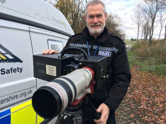 PC Sean Graham with the new long-range camera at the A417. SWBRcamera; Gloucestershire police have revealed a new weapon in their battle against dangerous driving and organised criminals - a mobile camera that can see clearly what drivers are doing from about 1,000m away. It means by the time you see the police with the camera, they have already seen you, know what you are doing and how fast you are travelling.