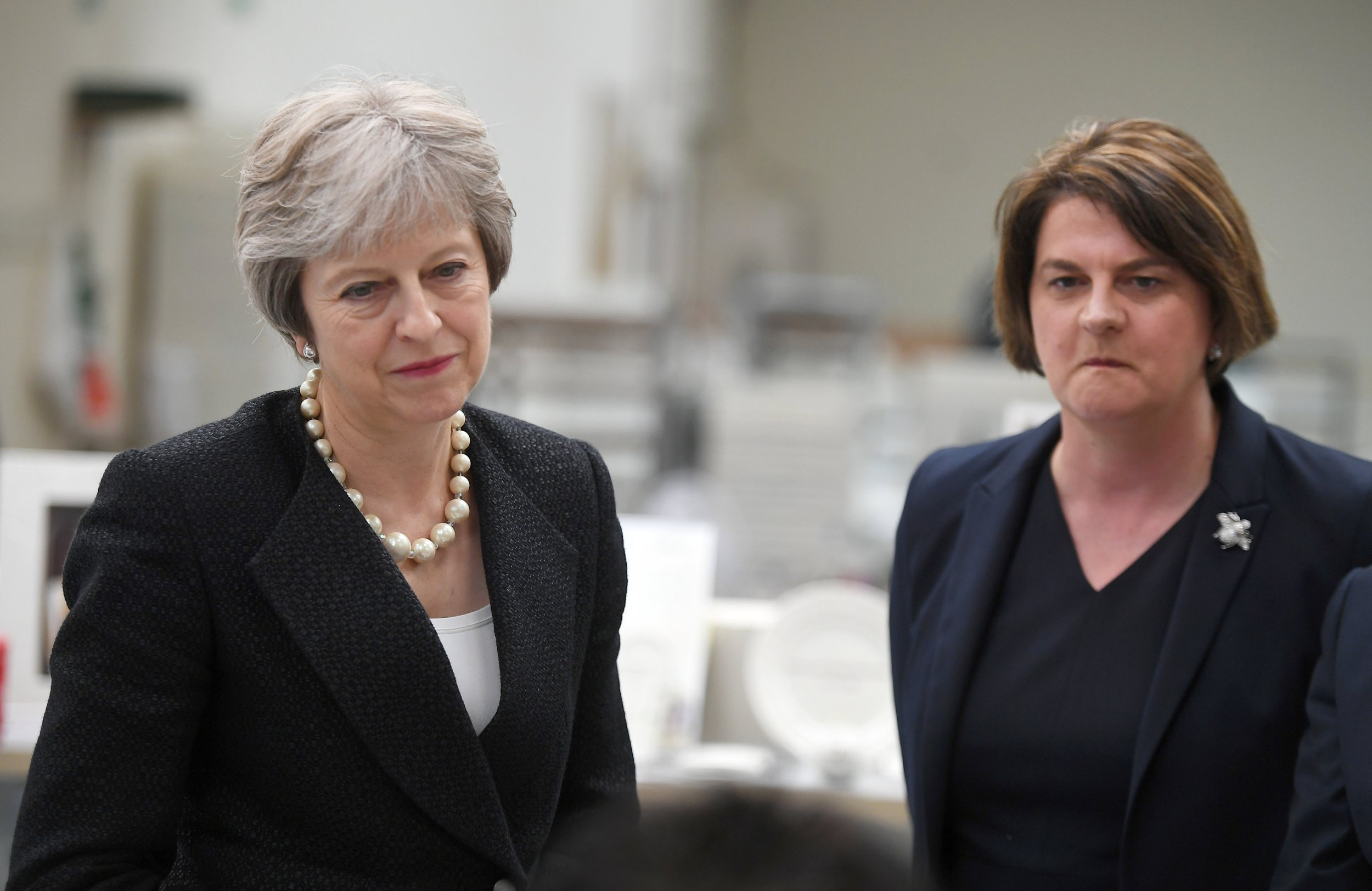 ST BELLEEK, NORTHERN IRELAND - JULY 19: British Prime Minister Theresa May and Arlene Foster, the leader of the Democratic Unionist Party (DUP) visit Belleek Pottery, on July 19, 2018 in St Belleek, Fermanagh, Northern Ireland. The Prime Minister is visiting Northern Ireland for the first time since becoming Prime Minister. She will visit the Irish border and discuss the potential impact of Brexit with Northern Irish businesses. (Photo by Clodagh Kilcoyne - WPA Pool/Getty Images)