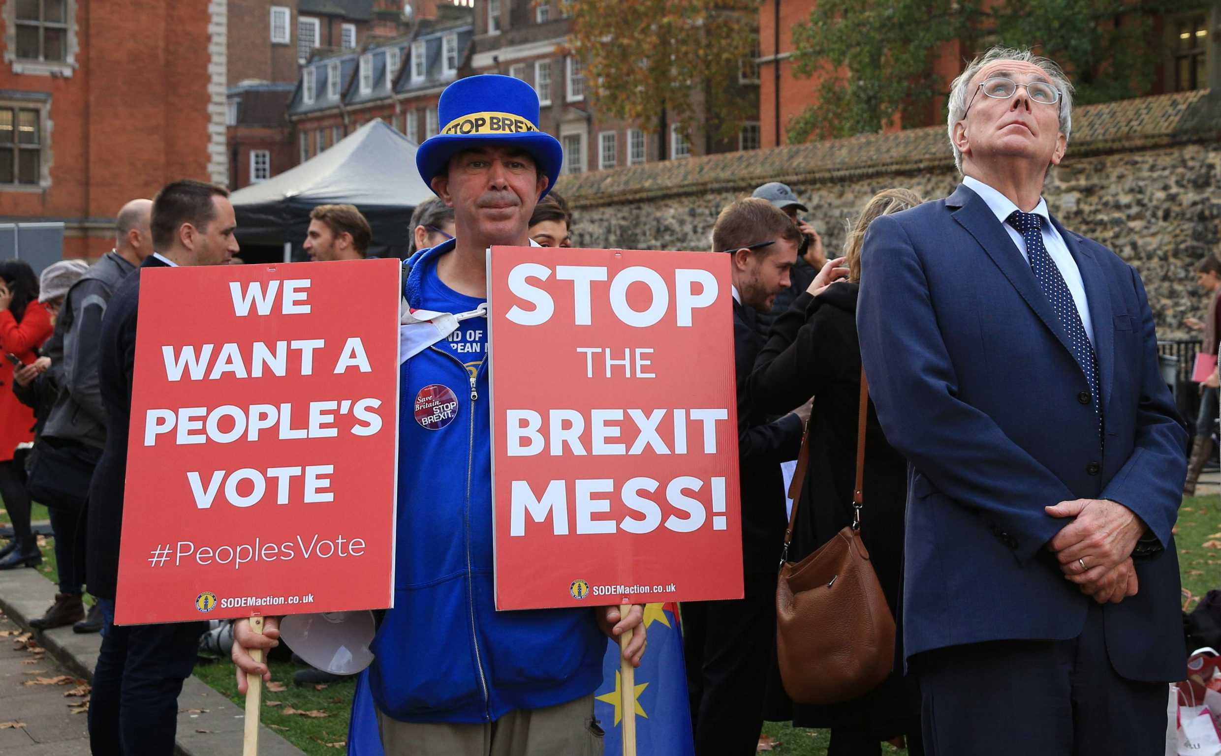 Mandatory Credit: Photo by Imageplotter/REX (9980700d) Peter Bone, MP in Westminster, with Anti-Brexit protester Steven Bray and his signs in the background. Brexit protest, London, UK - 15 Nov 2018