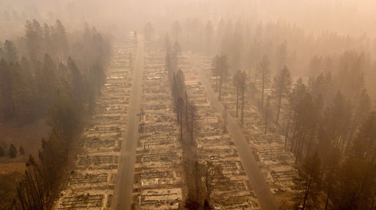 In this aerial photo, a burned neighborhood is seen in Paradise, California on November 15, 2018. - The toll in the deadliest wildfires in recent California history climbed to 59 on November 14, 2018, as authorities released a list of 130 people still missing. (Photo by Josh Edelson / AFP)JOSH EDELSON/AFP/Getty Images