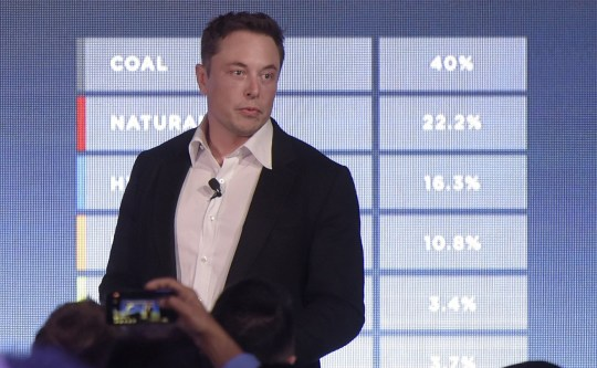 Elon Musk, co-founder and chief executive officer of Tesla Inc., speaks during an event at the Hornsdale wind farm, operated by Neoen SAS, near Jamestown, South Australia, on Friday, Sept. 29, 2017. Against a backdrop of wind turbines 150 miles (241 kilometers) north of Adelaide, Musk announced a contract to build the??world's largest??lithium-ion battery system had been signed with South Australia's power distributor, triggering a 100-day self-imposed deadline to install the electricity storage system. Photographer: Carla Gottgens/Bloomberg via Getty Images