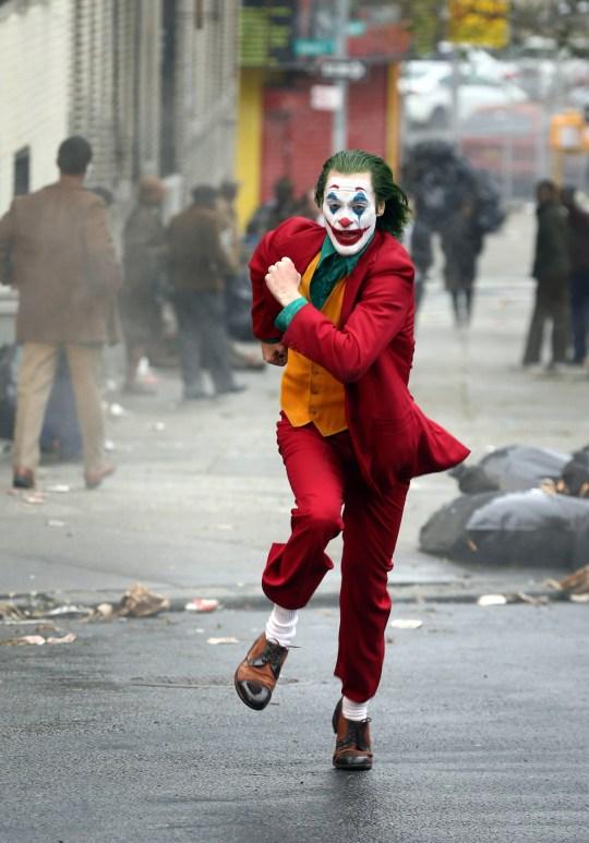 The Joker's Joaquin Phoenix gets struck by a taxi in stunt ...