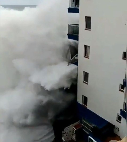 METRO GRAB VIA TWITTER THIS is the dramatic moment huge waves destroy seafront balconies at apartments on the holiday island of Tenerife, prompting police-led evacuations to ensure residents' safety. https://twitter.com/NelsonAcosta80/status/1064154682392756224