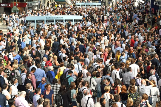 Commuters at Waterloo Station, London, as rail services to and from the railway station were disrupted for a second successive day on Tuesday after a fire under a train.