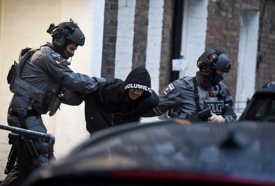 ? Licensed to London News Pictures. 19/11/2018. London, UK. A man being detained by police during a raid by a CT-SFO (Counter Terrorist Specialist Firearms Officer) unit at a residential block of flats in Westminster, London. A number of men were detained at the scene. Photo credit: Ben Cawthra/LNP