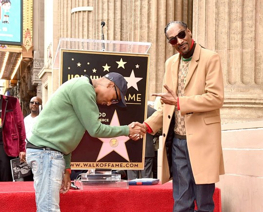 LOS ANGELES, CA - NOVEMBER 19: Snoop Dogg, with Pharrell Williams (L) is honored with a star on The Hollywood Walk Of Fame on Hollywood Boulevard on November 19, 2018 in Los Angeles, California. (Photo by Kevin Winter/Getty Images)
