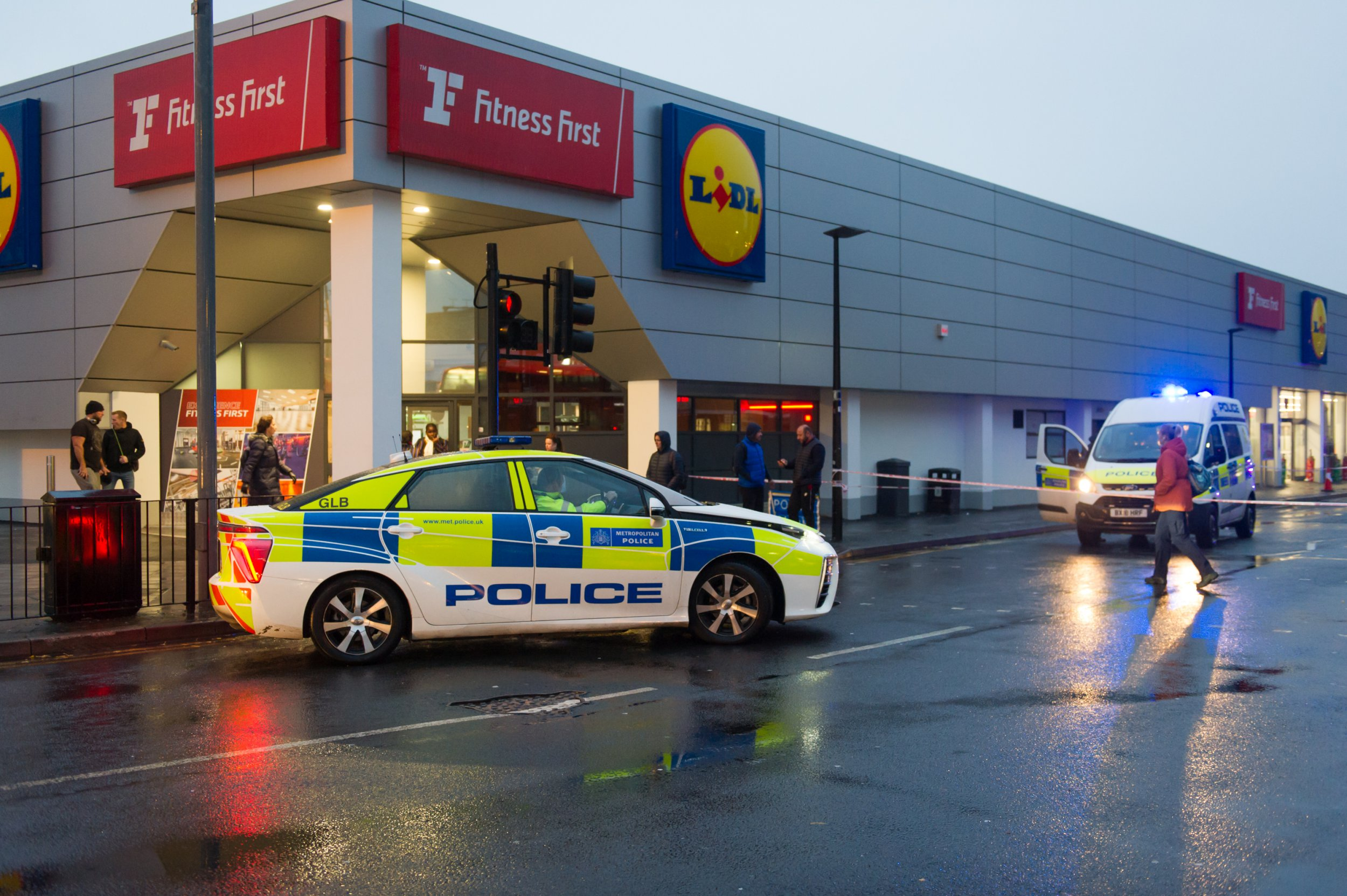 Image ??Licensed to i-Images Picture Agency. 20/11/2018. London, United Kingdom. Romford Lidl stabbing. A police cordon can be seen around the crime scene. A man has been stabbed outside a Lidl in Romford. Police said officers were called at 13:19hrs to reports of a 19-year-old male knifed at the supermarket in Atlanta Boulevard. Officers, LAS and London's Air Ambulance attended the scene and the teen was found with stab injuries. He has been taken to a east London hospital and his condition is not known. Picture by Gustavo Valiente / i-Images