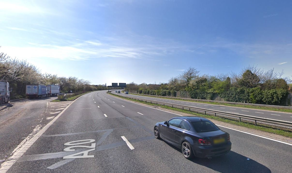 Two men killed while assisting the driver of an overturned car on the A20