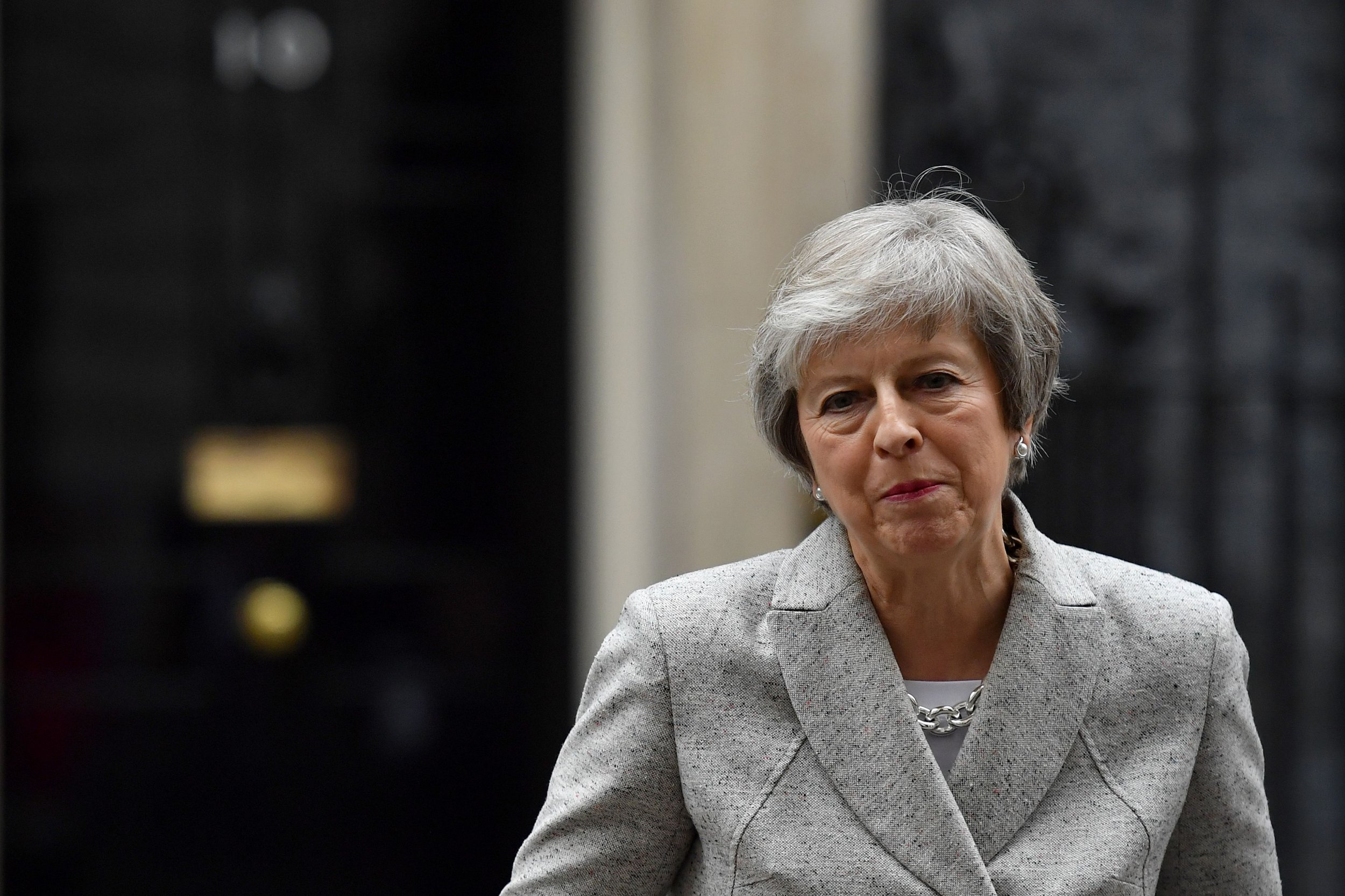 """Britain's Prime Minister Theresa May gives a statement outside 10 Downing Street in central London on November 22, 2018, following the announcement of a draft deal on post-Brexit trade ties with the EU. - British Prime Minister Theresa May was briefing her cabinet on a draft deal on post-Brexit trade ties with the EU before making a statement to MPs on Thursday afternoon, officials said. """"The prime minister will be making a statement to the House (of Commons) later today,"""" leader of the House of Commons Andrea Leadsom said earlier Thursday, after the deal was announced in Brussels. (Photo by Ben STANSALL / AFP)BEN STANSALL/AFP/Getty Images"""