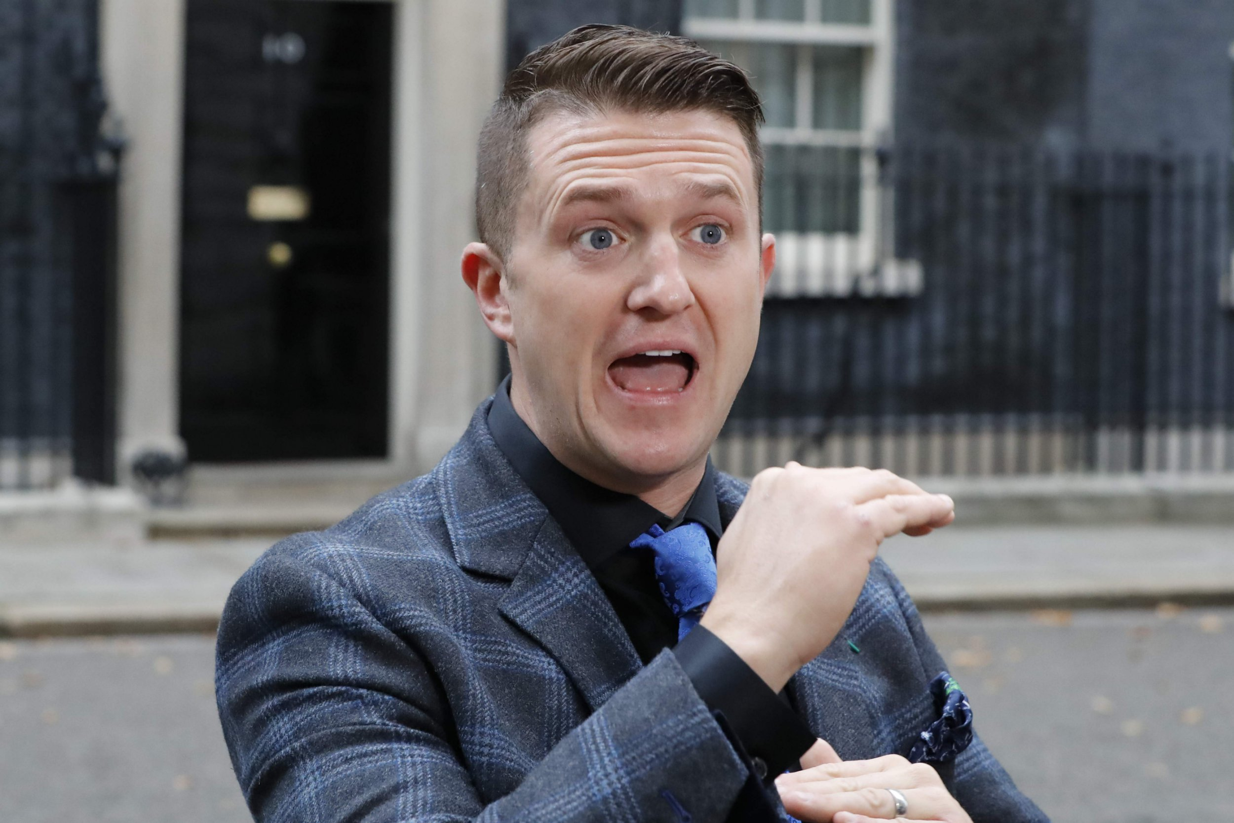"Founder and former leader of the anti-Islam English Defence League, Stephen Yaxley-Lennon, AKA Tommy Robinson, talks to the media after delivering a petition to 10 Downing Street in central London on November 6, 2018. - The head of the UK Independence Party has appointed leading far-right activist Stephen Yaxley-Lennon, AKA Tommy Robinson, as a personal adviser, prompting UKIP's former leader Nigel Farage to call for his ouster amid accusations of Islamophobia. UKIP chief Gerard Batten told the BBC on November 23, 2018 that Yaxley-Lennon, a hugely divisive figure who founded the anti-Islam English Defence League, had been appointed as his adviser on ""rape gangs and prison reform"". (Photo by TOLGA AKMEN / AFP)TOLGA AKMEN/AFP/Getty Images"