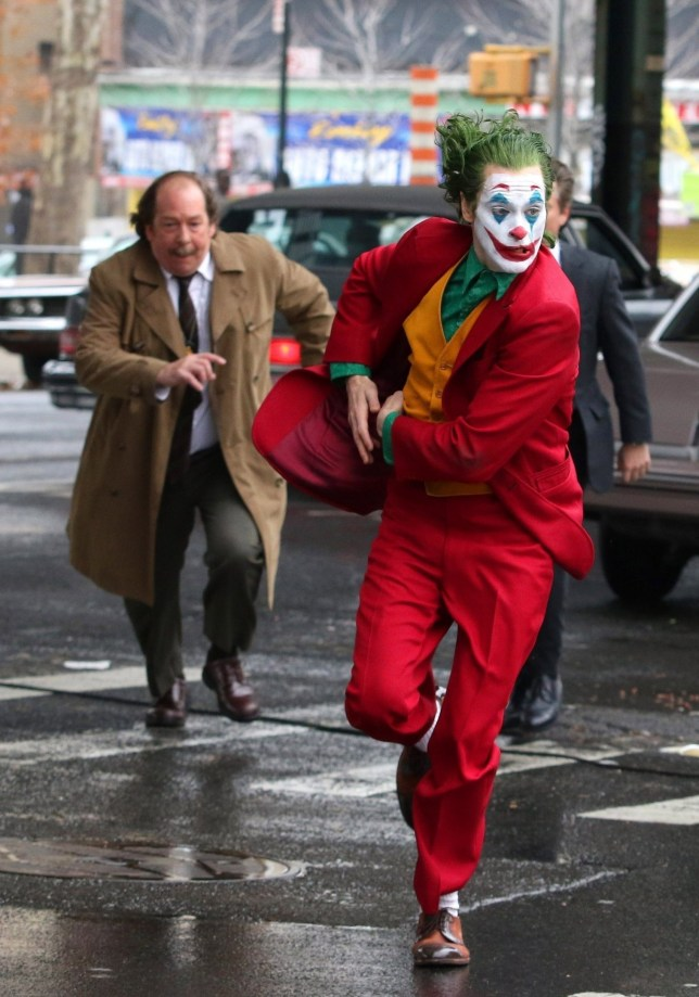 """New York, NY - Joaquin Phoenix is seen in full costume as the Clown Prince of Crime super villain The Joke. Joaquin films additional scenes for an intense action chase sequence Sunday morning for the upcoming movie """"JOKER"""" with costars Shea Whigham and Bill Camp. The scene involved The Joker running away from two Gotham Police Detectives on a very gritty and seedy Subway Station in the Bronx. Pictured: Joaquin Phoenix, Shea Whigham and Bill Camp BACKGRID USA 25 NOVEMBER 2018 BYLINE MUST READ: BrosNYC / BACKGRID USA: +1 310 798 9111 / usasales@backgrid.com UK: +44 208 344 2007 / uksales@backgrid.com *UK Clients - Pictures Containing Children Please Pixelate Face Prior To Publication*"""