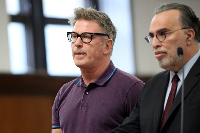 CORRECTS PHOTOGRAPHER'S LAST NAME TO TABAK FROM TABEK - Actor Alec Baldwin, left, and attorney Alan Abramson appear in New York Supreme Court, in New York, Monday, Nov. 26, 2018. Baldwin appeared in a New York court on Monday after being accused of striking a man in the face over a parking space. (Alec Tabak/The Daily News via AP, Pool)