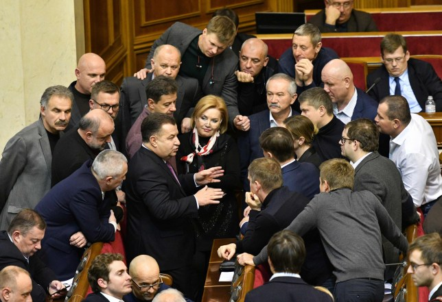 Ukrainian Defence Minister Stepan Poltorak (C) speaks to Ukrainian MPs before opening an emergency session at Parliament in Kiev on November 26, 2018, ahead of a parliamentary vote on the request of the Ukrainian President to impose martial law in the country. - Kiev and Moscow were facing their worst crisis in years on November 26 as Ukraine and its Western allies demanded the release of three ships fired on and seized by Russia near Crimea. Russian vessels boarded and captured the ships on November 25, accusing them of illegally entering Russian waters off the coast of Crimea in the Sea of Azov. Ukraine's President Poroshenko addressed the nation ahead of a parliamentary vote on his request to impose martial law in the country. The Ukrainian leader said he would ask parliament to introduce martial law for 30 days, after initially saying it would last 60 days. (Photo by Genya SAVILOV / AFP)GENYA SAVILOV/AFP/Getty Images