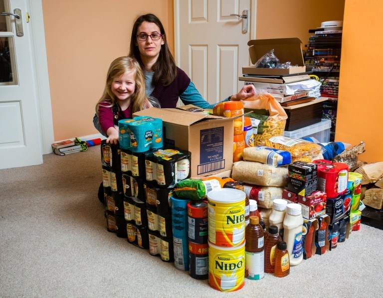 """Nevine Man with her daughter Paige aged 5, at their home in Illogan, Cornwall. See SWNS story SWPLbrexit; A family preparing for Brexit by stockpiling 'essential' items - including tea bags, baked beans and MARMITE. A family are preparing for Brexit by stocking up on essential items - including tea bags, baked beans and MARMITE. Nevine Mann, 36, and her 37-year-old husband Richard have been buying extra ingredients each time they go shopping. Now, the amassed goods on their kitchen table are enough to survive a no-deal Brexit for at least four months. But Nevine, who lives in Illogan, Cornwall, with her three children Oliver, 18, Ethan, 13 and Paige, five, insists this isn't about luxuries - but is a matter of survival. Nevine, a former midwife, said: """"A little while ago we were aware that Brexit was in the offing, and it seemed like there would be issues with securing a deal. """"The results of a no deal Brexit would be catastrophic in terms of getting supplies in the country, certainly in the short term."""
