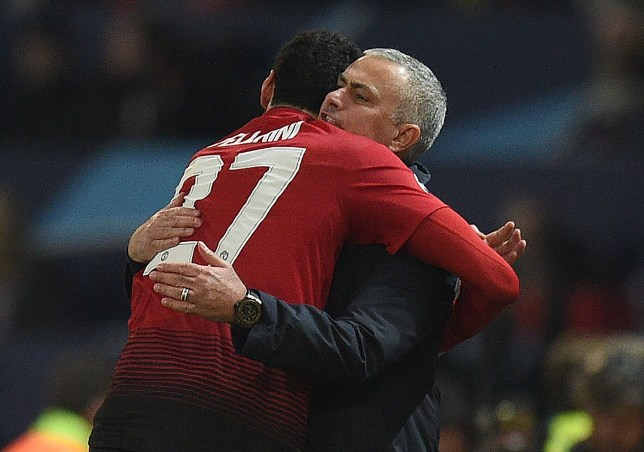 Manchester United's Belgian midfielder Marouane Fellaini (L) celebrates scoring the opening goal with Manchester United's Portuguese manager Jose Mourinho during the UEFA Champions League group H football match between Manchester United and Young Boys at Old Trafford in Manchester, north-west England on November 27, 2018. (Photo by Oli SCARFF / AFP)OLI SCARFF/AFP/Getty Images