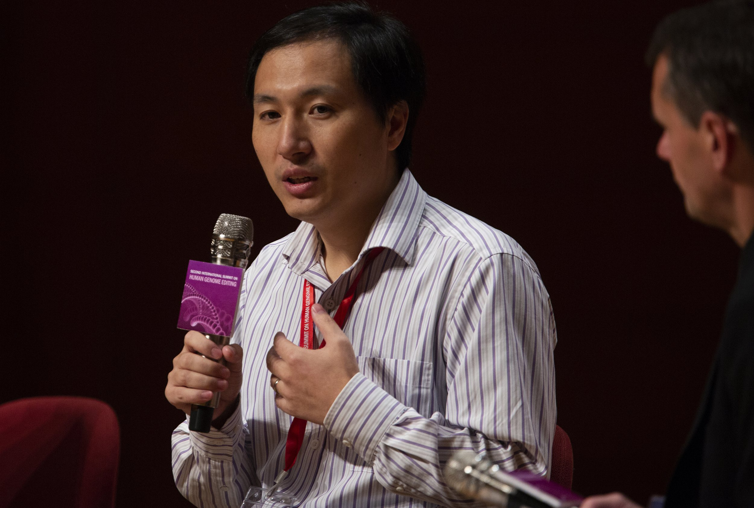 epa07194188 Mainland Chinese scientist He Jiankui defends his work during a panel discussion at the Second International Summit on Human Genome Editing, at the University of Hong Kong in Hong Kong, China, 28 November 2018. He Jiankui claims to have created the world's first genetically-edited twin babies, named Lulu and Nana, and has defended his work amid a storm of criticism from the world's scientific community. Critics have called the scientist's work medically unnecessary and ethically questionable. EPA/ALEX HOFFORD