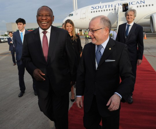 """This handout picture released by G20 Summit's Press Office shows South Africa's President Cyril Ramaphosa (R) being welcomed by Argentinas Foreign Affairs Minister Jorge Faurie, shortly after arriving at Ezeiza International airport in Buenos Aires province, on November 29, 2018. - Global leaders gather in the Argentine capital for a two-day G20 summit beginning on Friday likely to be dominated by simmering international tensions over trade. (Photo by HO / G20 PRESS OFFICE / AFP) / RESTRICTED TO EDITORIAL USE - MANDATORY CREDIT """"AFP PHOTO -G20 PRESS OFFICE"""" - NO MARKETING NO ADVERTISING CAMPAIGNS - DISTRIBUTED AS A SERVICE TO CLIENTS -HO/AFP/Getty Images"""