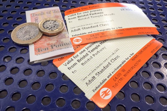 File photo dated 14/8/2018 of off-peak day return rail tickets and money. Britain???s rail fares will increase by an average of 3.1% on January 2, industry body the Rail Delivery Group said. PRESS ASSOCIATION Photo. Issue date: Friday November 30, 2018. Many long-distance commuters will see the annual cost of getting to work rise by more than ??100 when the new fares come into force on January 2. See PA story RAIL Fares. Photo credit should read: Ben Birchall/PA Wire