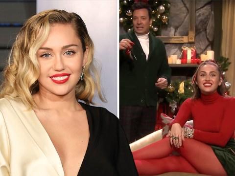 Miley Cyrus don't need no man as she puts a feminist vegan spin on Santa Baby lyrics
