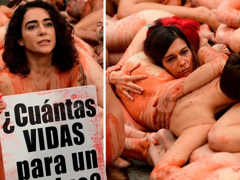 Activists strip naked and smear themselves in fake blood to protest against fur