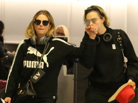 Cara Delevingne and Ashley Benson hold hands as they arrive at Gatwick amid drone chaos
