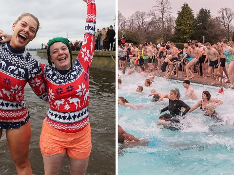 Festive swimmers brave the icy water for a traditional Christmas dip