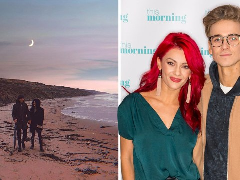 Joe Sugg has us swooning as he holds hands with Dianne Buswell on the beach
