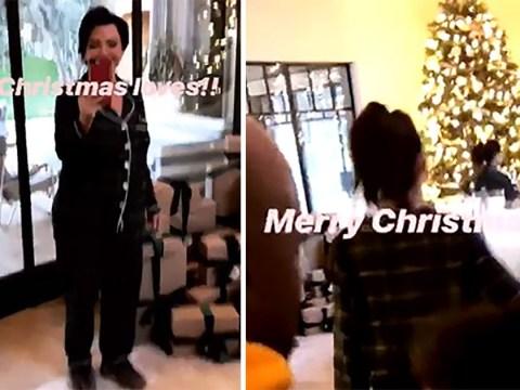 The Kardashians take Christmas: Khloe reveals mountain of presents as Kim goes sledding with North