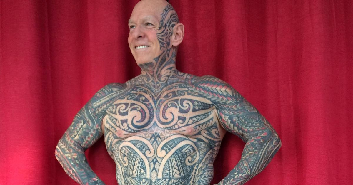 A bodybuilder wrapped his penis around a kitchen rolling pin to have his entire private parts - including his testicles - covered in tattoo