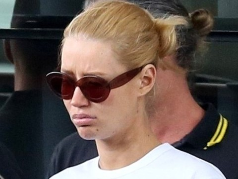 Iggy Azalea looks downcast as she's spotted out amid concerns over worrying Instagram post