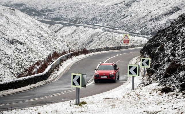 A car navigates the Snake Pass in Derbyshire, as a blast of snow hits the north of England. PRESS ASSOCIATION Photo. Picture date: Wednesday November 21, 2018. See PA story WEATHER Cold. Photo credit should read: Danny Lawson/PA Wire