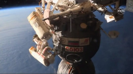 epa07225680 A frame from a video made available by NASA shows Russian cosmonaut Oleg Kononenko (bottom) cutting into the hull of the Soyuz orbital module to examine the area of a pressure leak, 11 December 2018 (issued 12 December 2018). According to NASA, Russian cosmonauts Oleg Kononenko and Sergey Prokopyev (top) performed a spacewalk to inspect the Soyuz crew vehicle where a pressure leak was detected and fixed in August 2018. EPA/NASA HANDOUT HANDOUT EDITORIAL USE ONLY/NO SALES