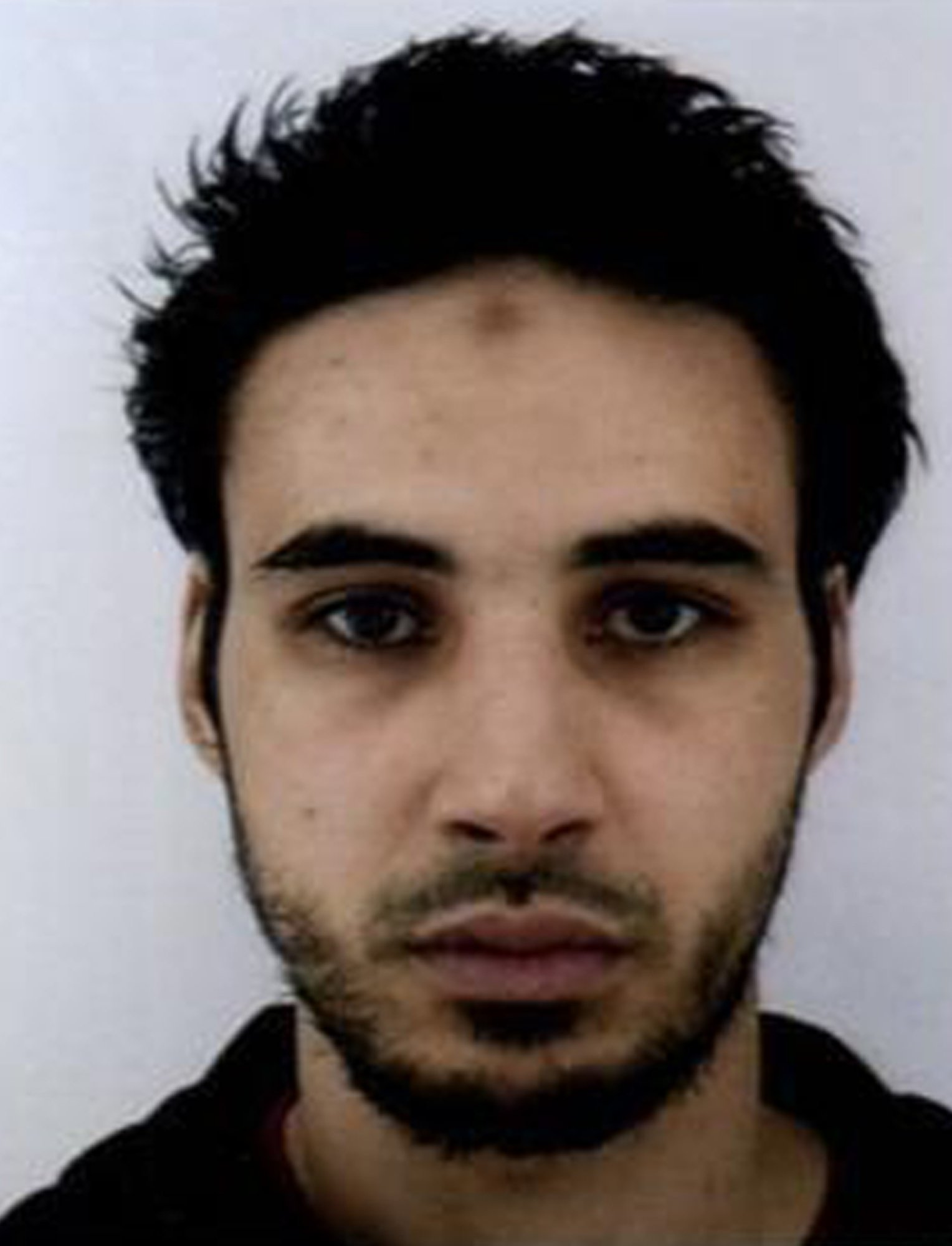This undated handout photo provided by the French police, shows Cherif Chekatt, the suspect in the shooting in Strasbourg, France on Tuesday Dec. 11, 2018. Police union officials identified the suspected assailant as Cherif Chekatt, a 29-year-old with a thick police record for crimes including armed robbery and monitored as a suspected religious radical by the French intelligence services. The suspect sprayed gunfire near the famous Christmas market in the eastern French city, killing three people, wounding up to a dozen and sparking a massive manhunt when he got away. (French Police via AP)