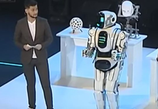 Russian hi-tech robot turns out to be just a man in a suit